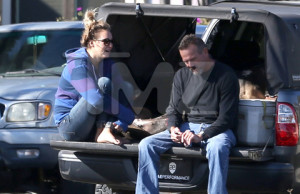 EXCLUSIVE: Jasmine Pilchard-Gosnell chats with friends outside Paul Walker' home.