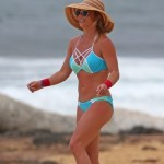 EXCLUSIVE: A bikini clad Britney Spears shows off her very toned and in shape body while throwing a ball on the beach in Hawaii.